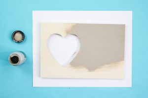 painting a heart cut out picture frame