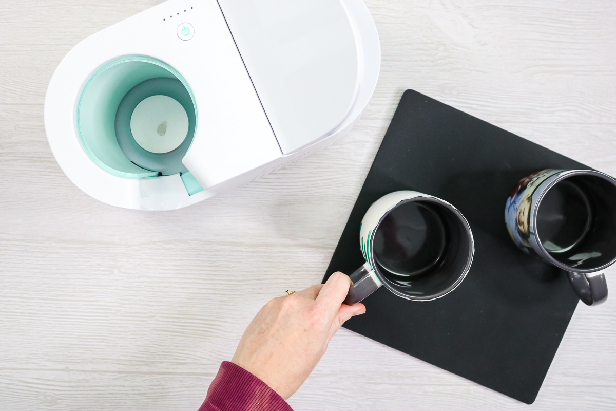 putting photo mug on a heat resistant mat