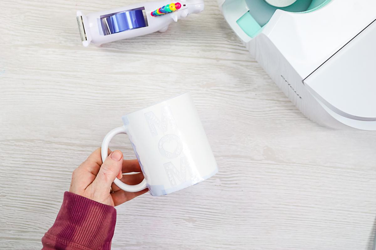 taping design onto a cricut mug