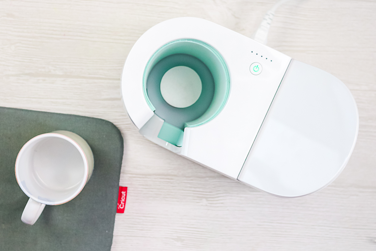 removing mug from the mug heat press