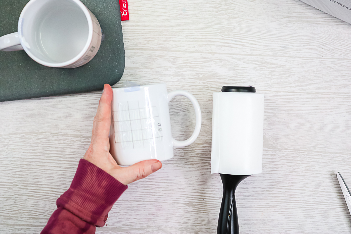 how to secure a design on a mug for pressing
