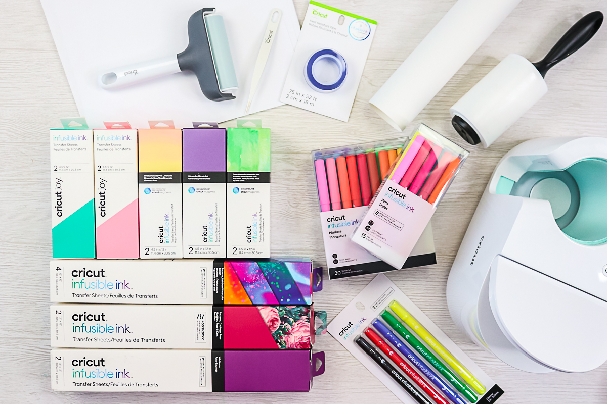 infusible ink supplies on a table with the cricut mug press