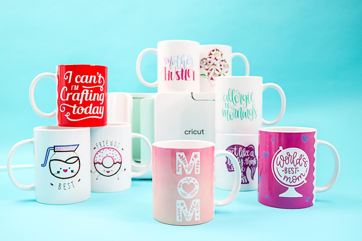 variety of mug designs made on the cricut mug press