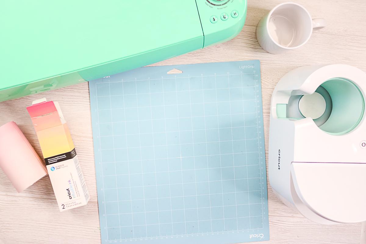 light blue cricut mat on a table