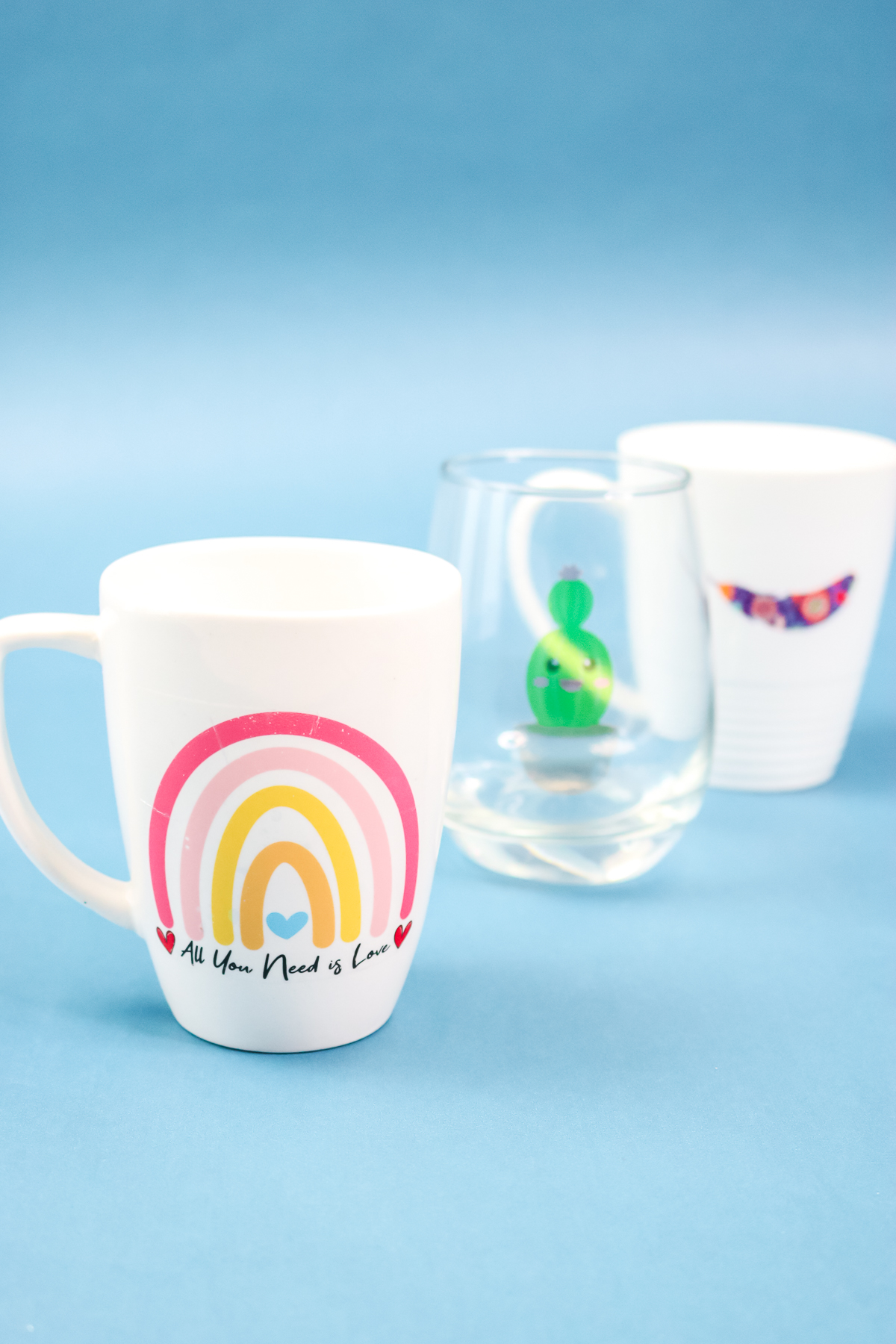 mugs and wine glasses with decals applied