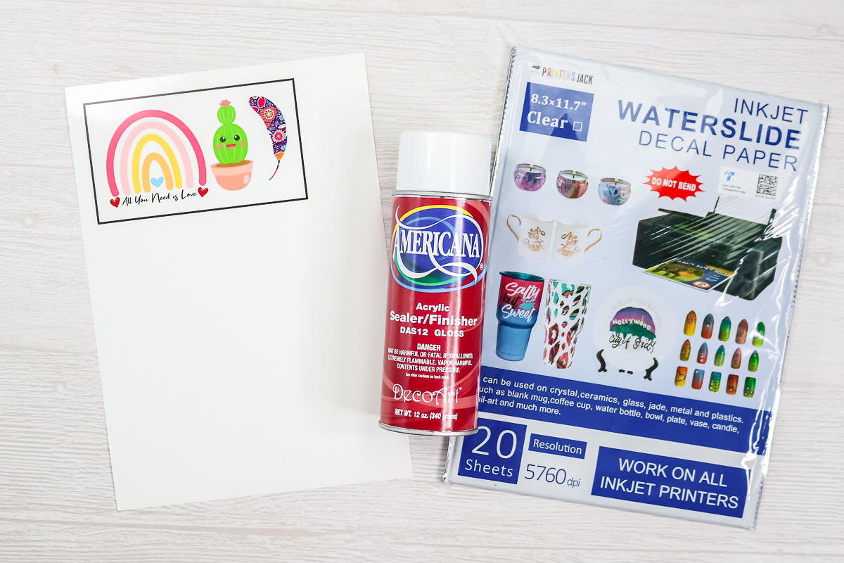 printed waterslide paper with spray sealer on a table