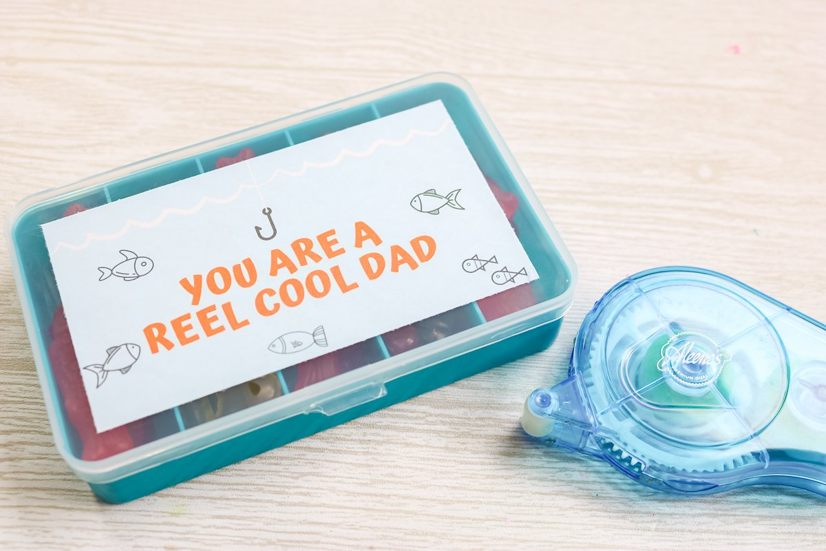 reel cool dad label on a tackle box