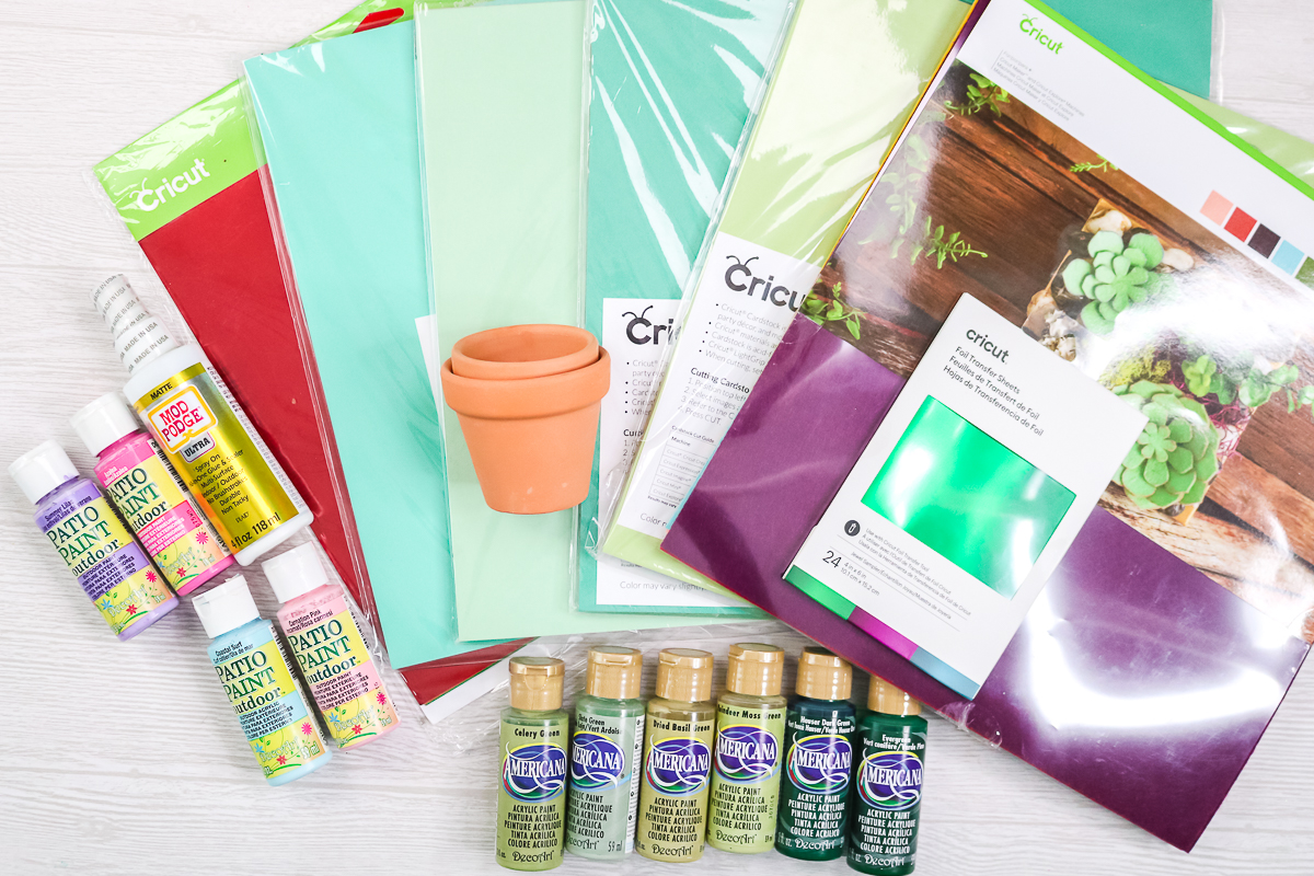 supplies to make paper plants on a table