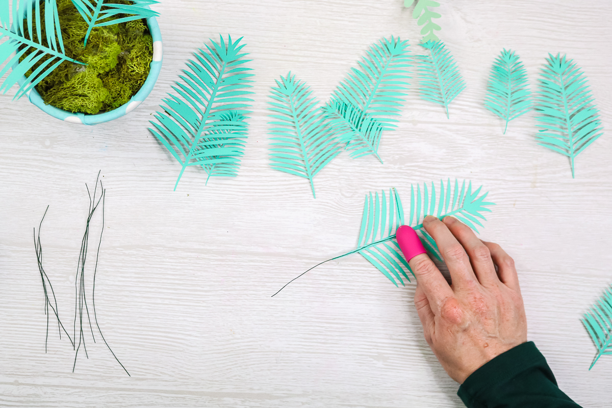 adding wire to paper plant leaves