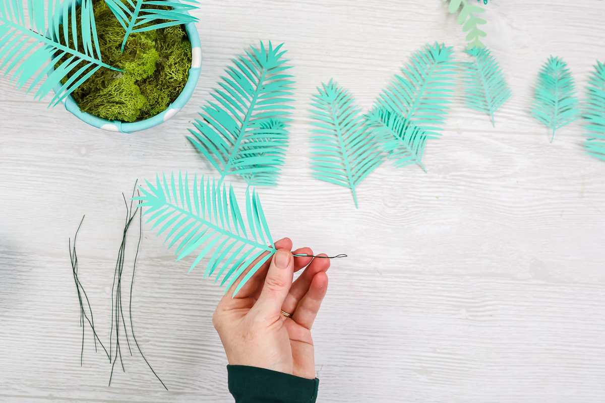 folding wire end over on plant leaves made from paper