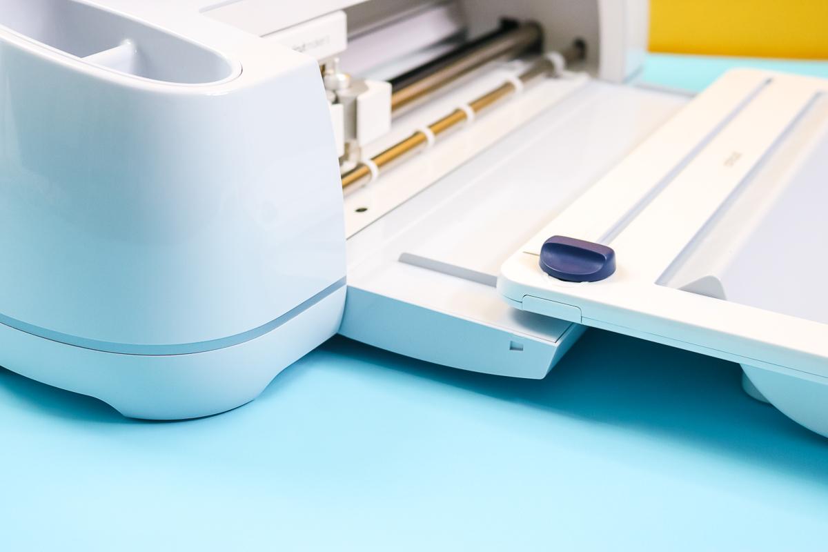 adding cricut roll holder to tray on a cricut machine