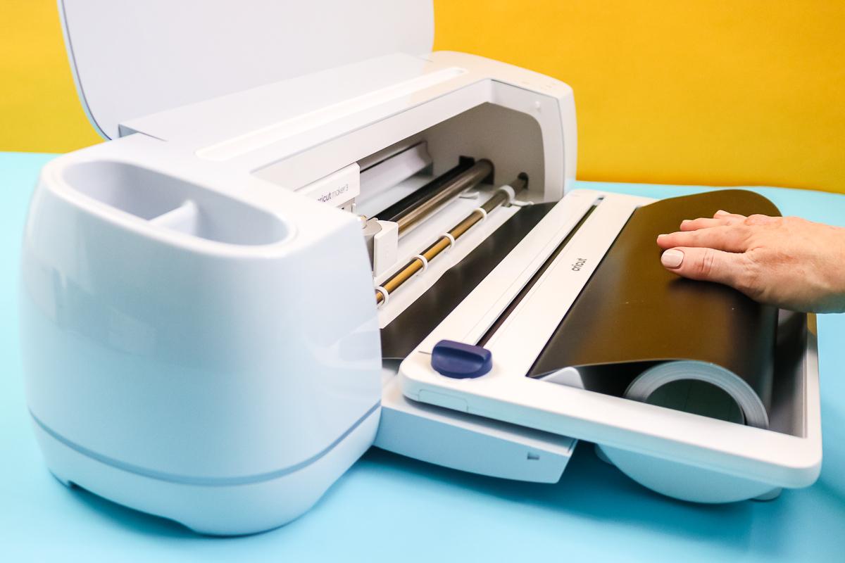 feeding smart vinyl through the cricut roll feeder