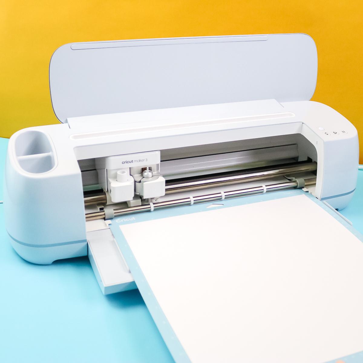 cricut maker 3 cutting material on a mat