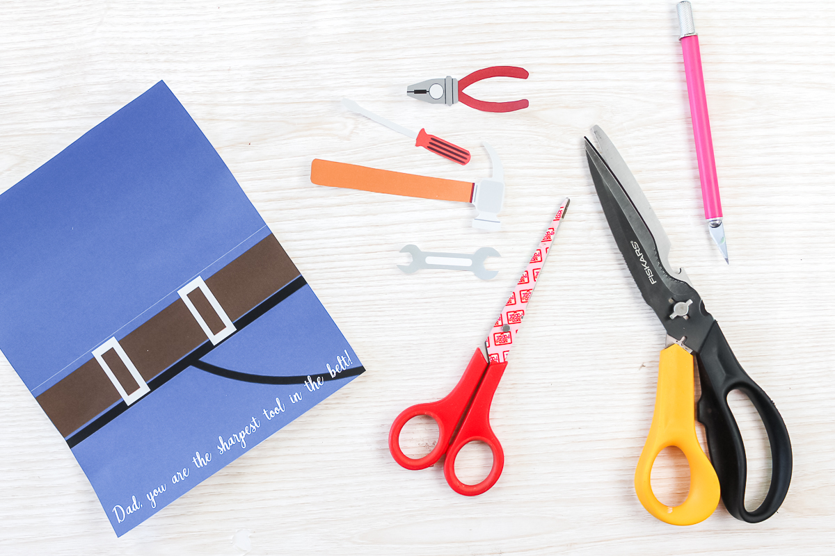 cutting out a printable father's day card