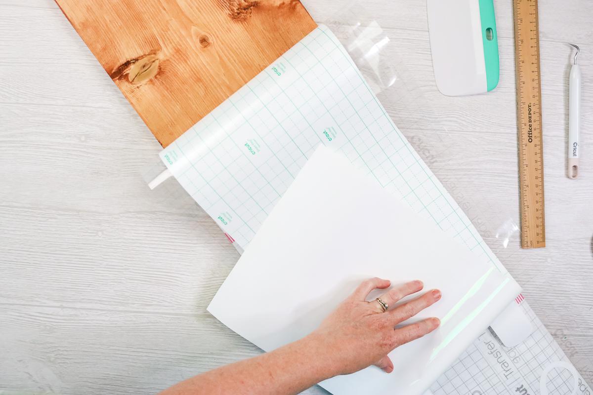 peeling back carrier sheet from vinyl