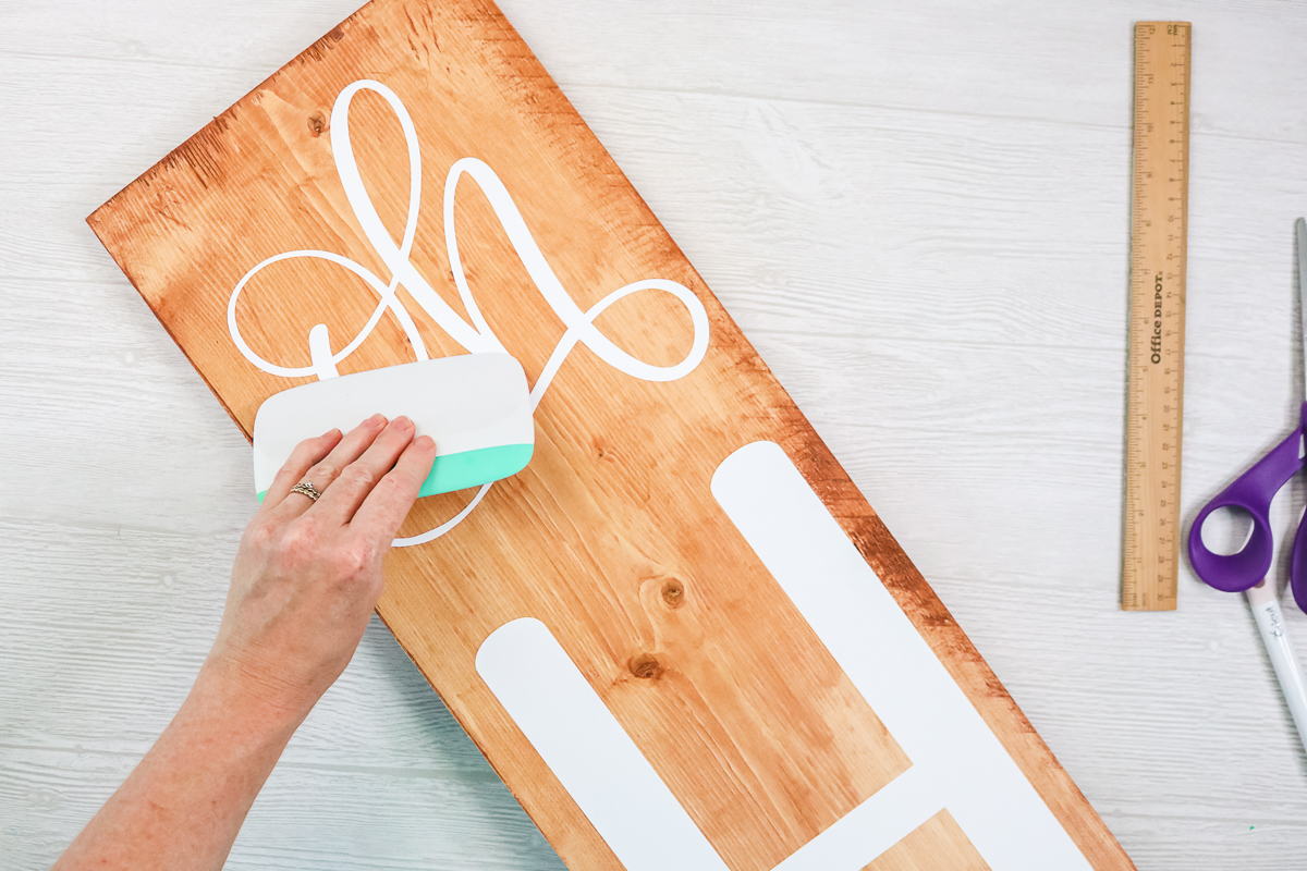 burnishing white vinyl on a wood sign