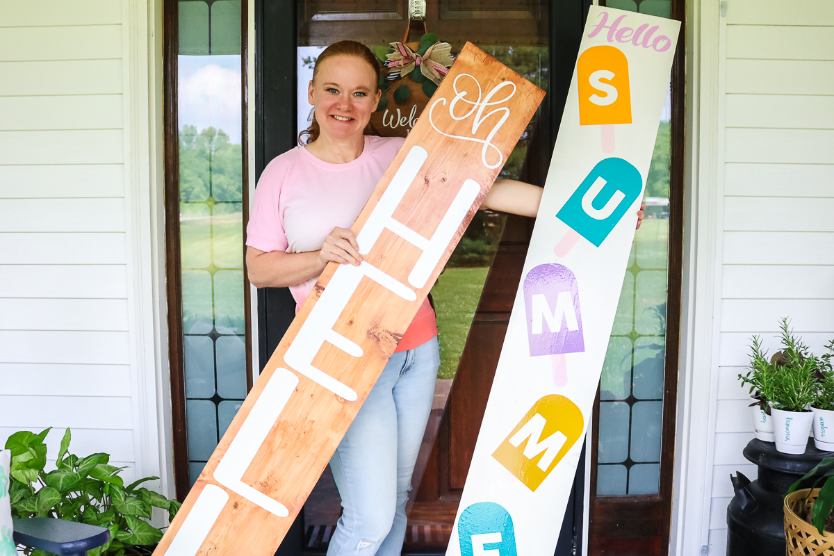 angie holden with signs on a porch