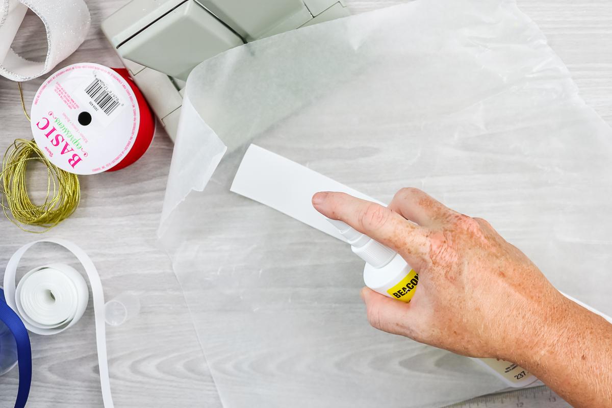 adding fabric stiffener spray to ribbon