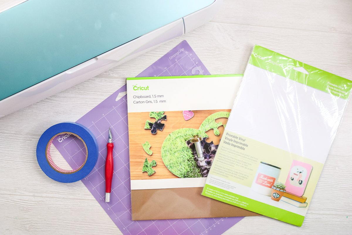 puzzle making supplies and a cricut maker on a table