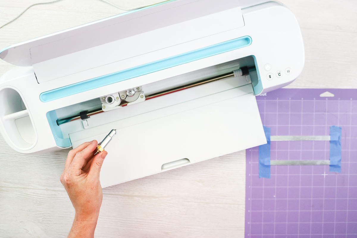 putting the engraving tip into the cricut maker