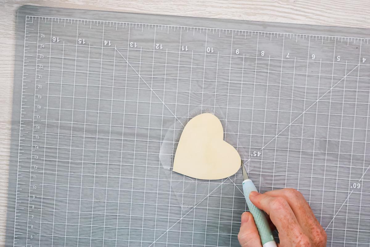 cutting away lamination sheet from wood heart