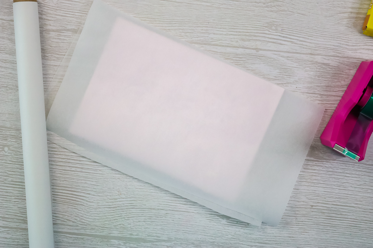 adding protective paper to sublimation blank