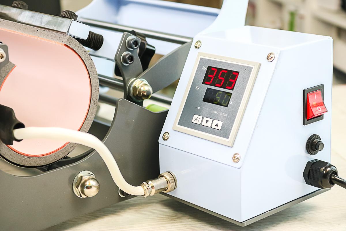 controls on a tumbler press