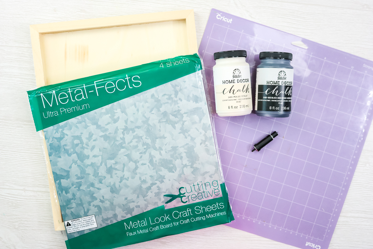 metalfects sheets and supplies to make a sign on a table