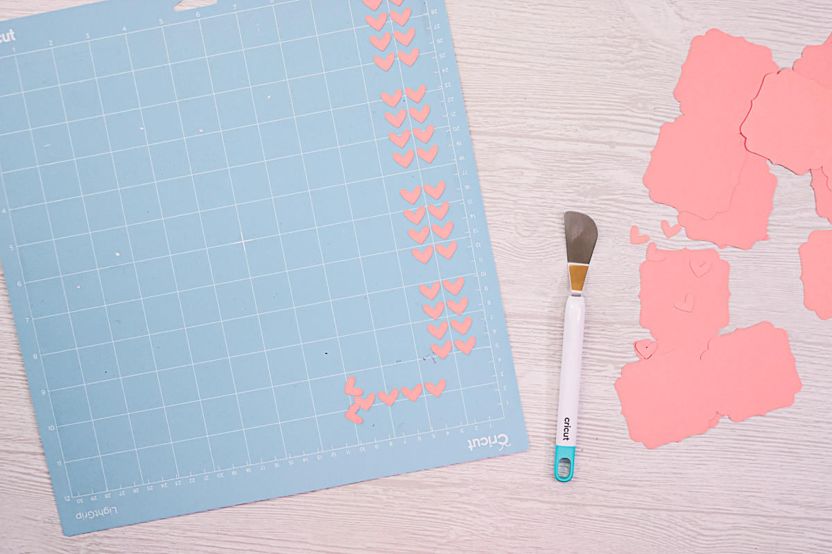 using spatula to remove small pieces from a cricut mat