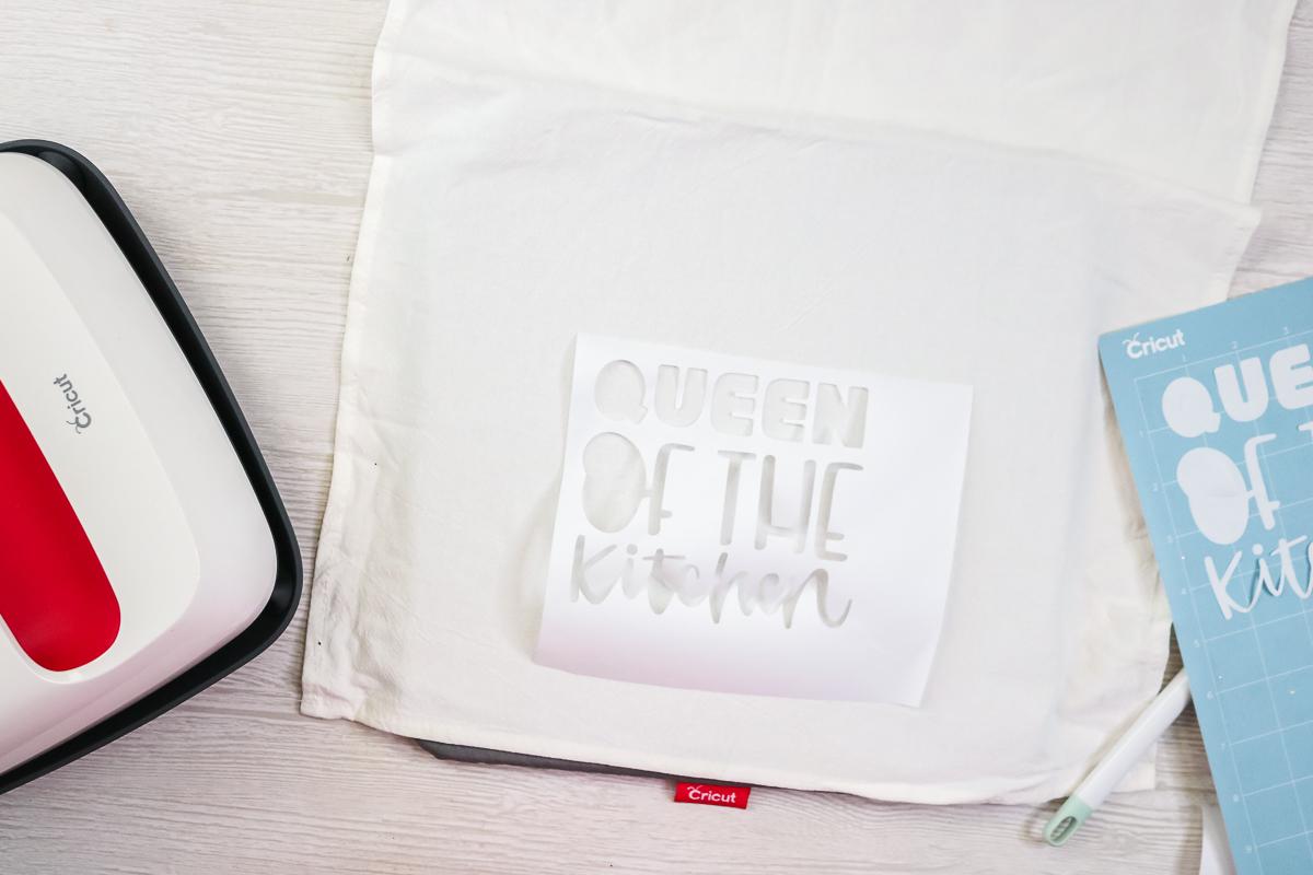 adding a freezer paper stencil to a tea towel