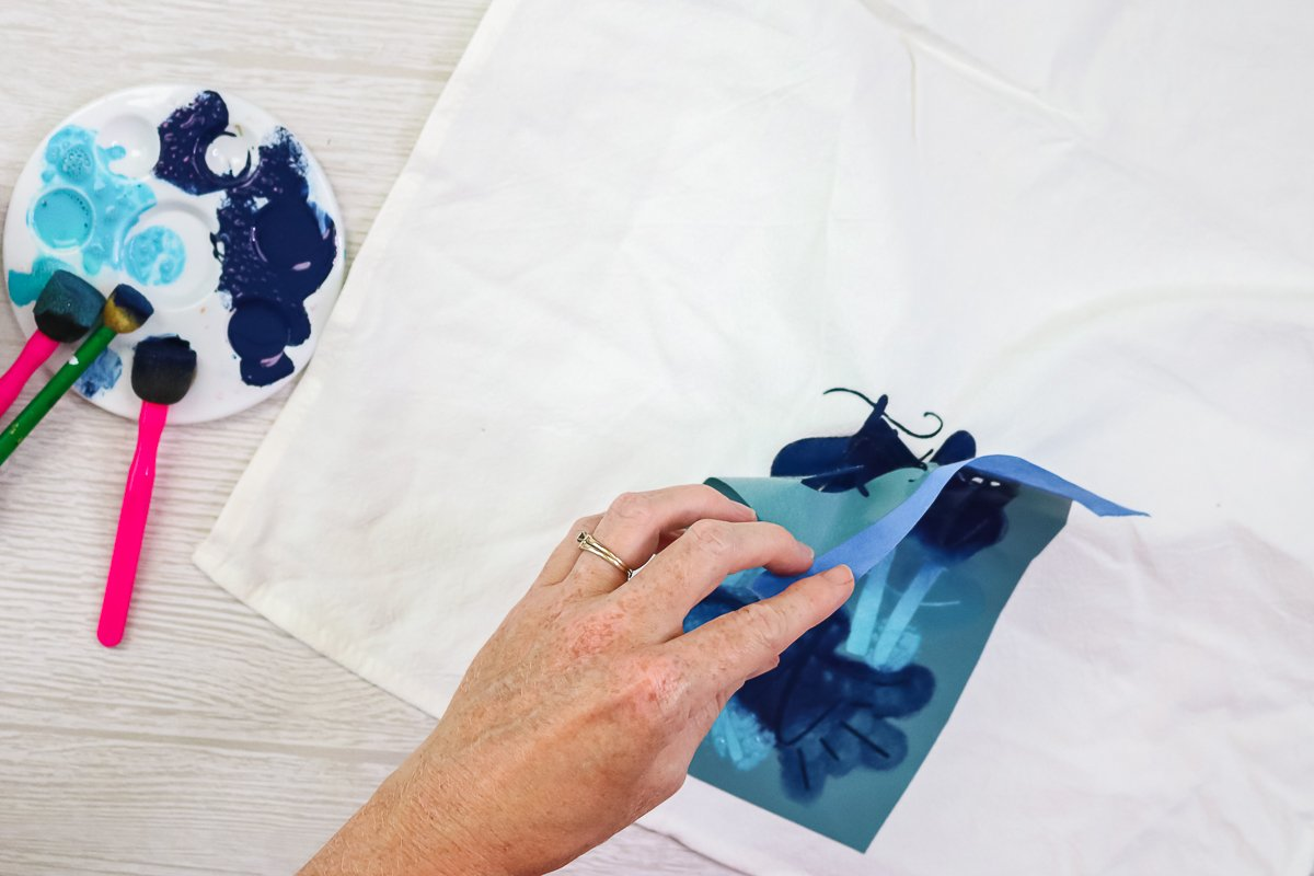 removing vinyl stencil from a tea towel