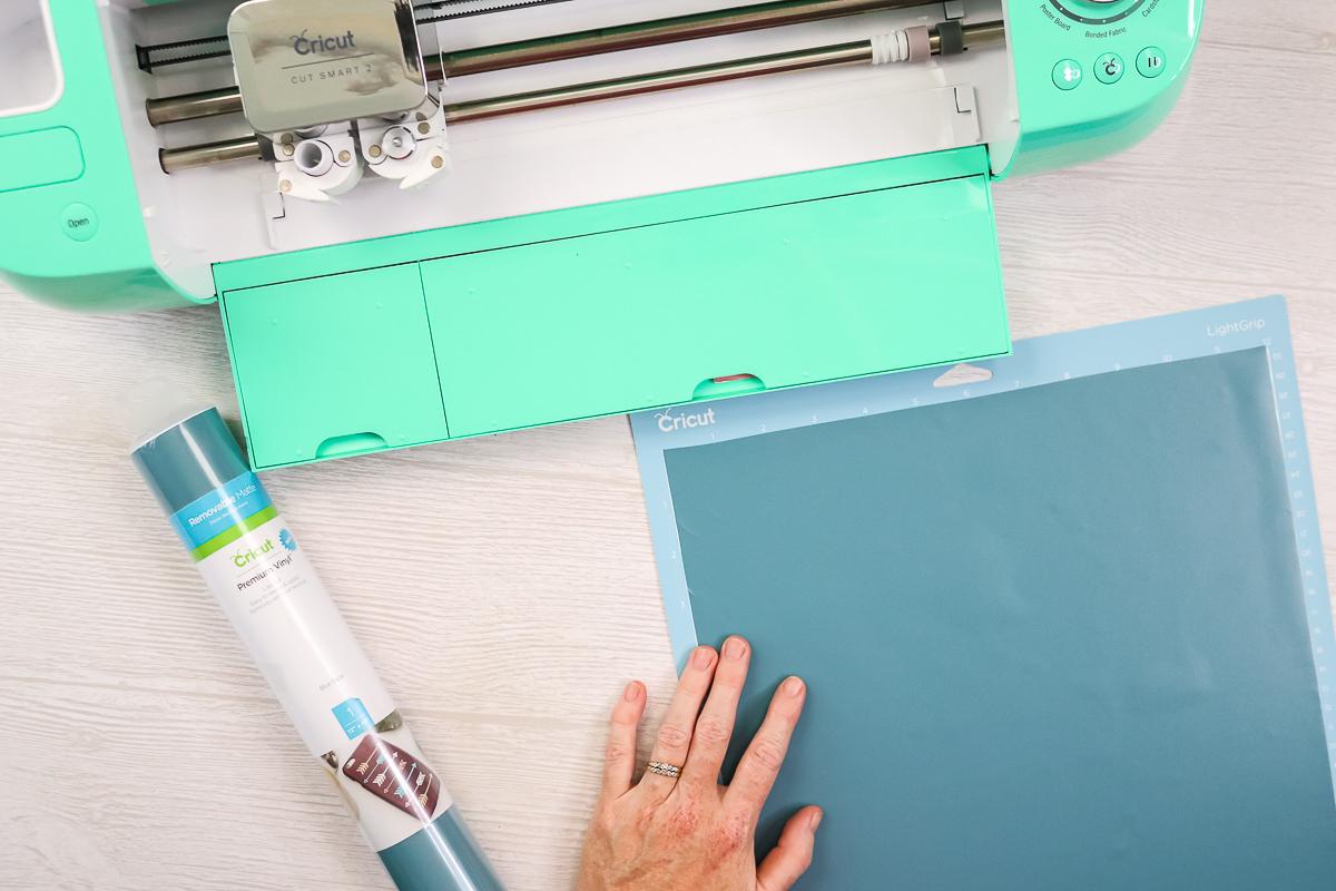 adding vinyl to a cricut mat